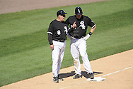 CHICAGO - MAY 21:  Third base coach Jeff Cox #8 of the Chicago White Sox talks things over with Brian Anderson #32 during the game against the Minnesota Twins on May 21, 2009 at U.S. Cellular Field in Chicago, Illinois.  The Twins defeated the White Sox 20-1.  (Photo by Ron Vesely)