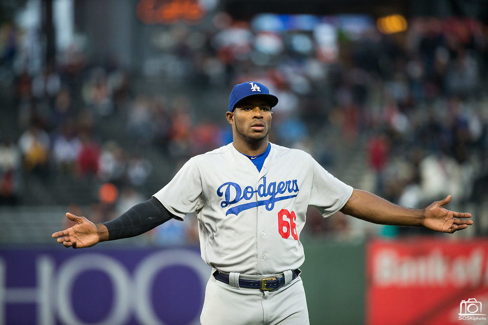Los Angeles Dodgers right fielder Yasiel Puig (66) warms up before taking on the San Francisco Giants at AT&T Park in San Francisco, California, on September 13, 2017. (Stan Olszewski/Special to S.F. Examiner)
