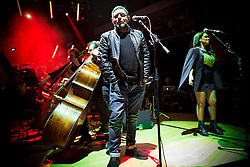 "© Licensed to London News Pictures . 05/02/2016 . Manchester , UK . SHAUN RYDER . "" Hacienda Classical "" debut at the Bridgewater Hall . The 70 piece Manchester Camerata and performers including New Order's Peter Hook , Shaun Ryder , Rowetta Idah , Bez and Hacienda DJs Graeme Park and Mike Pickering mixing live compositions . Photo credit : Joel Goodman/LNP"
