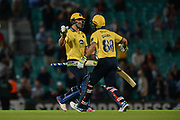 Grant Elliott & Colin de Grandhomme celebrate as Birmingham Bears beat Surrey by  six wickets during the NatWest T20 Blast South Group match between Surrey County Cricket Club and Warwickshire County Cricket Club at the Kia Oval, Kennington, United Kingdom on 25 August 2017. Photo by Dave Vokes.