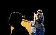 "Actress Rosario Dawson speaks on the microphone before U.S. Democratic Presidential candidate Senator Bernie Sanders (I-Vt.) takes the stage at the ""Future to Believe In"" Rally at the Kohl Center in Madison, Wisconsin April 3, 2016."
