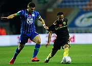 Samy Morsy(5) of Wigan Athletic and Rico Henry(3) of Brentford during the EFL Sky Bet Championship match between Wigan Athletic and Brentford at the DW Stadium, Wigan, England on 9 November 2019.