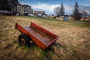 This old red cart is one of the many abandoned vehicle parts