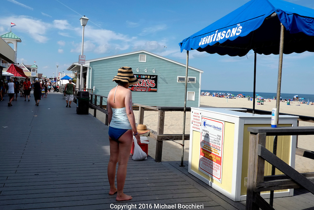 POINT PLEASANT BEACH, NJ - July 26: A woman stands at Jenkinson's Boardwalk on July 26, 2016 in POINT PLEASANT BEACH, NJ.  (Photo by Michael Bocchieri/Bocchieri Archive)