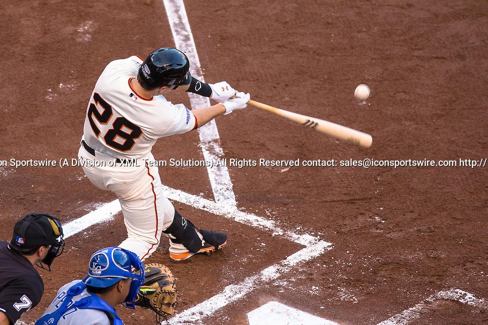 October 24, 2014: San Francisco Giants catcher Buster Posey (28) at bat and connecting with the ball, during game three of the World Series between the San Francisco Giants and the Kansas City Royals at AT&T Park in San Francisco, California, USA.
