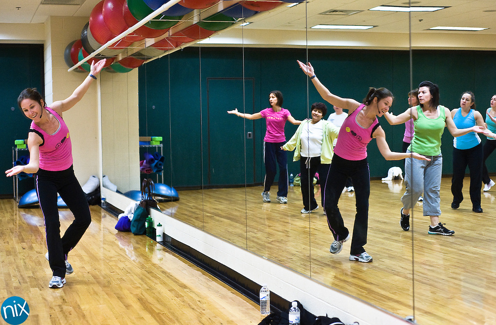 Michelle Siner, at left, leads a Zumba class at the West Cabarrus YMCA Friday morning.