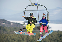 Gunstock Freestyle Academy Coach Patrick Morrison and Alexa Mailloux on the Pistol Chair at Gunstock Mountain Saturday morning.  (Karen Bobotas/for the Laconia Daily Sun)