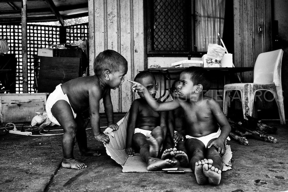 Kids playing at their family home in Kennedy Hill, despite poverty children are being children. Quane (1 yr), Meah (3 yr), Kitana (3 yr) and Marjorie (4 yr) (from L to R), Broome, Western Australia. ©Ingetje Tadros/Diimex
