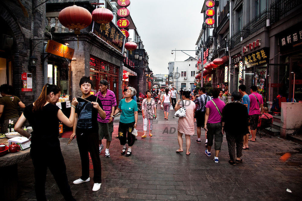 Streets of Dashilar. Dashilar should be the most ancient, famous and distinctive commercial street in hutongs of Beijing. Located outside the Qianmem Gate, Dashilar Street takes dozens of steps to walk from southwest of Tian'anmen Square to its east end. Dashilar originated in the Yuan Dynasty (1271-1368) and was finally built in the Ming Dynasty by local people, who put wooden gates at both ends of the street. In the Qing Dynasty and beyond, Dashilar was enlarged and grew in prosperity day by day. Eight Beijing old stores are still located there. .*** General Caption *** In view of Beijing Design Week, a look at the places where there are most of the events.