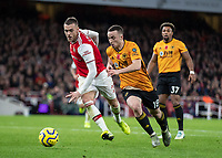 Football - 2019 / 2020 Premier League - Arsenal vs. Wolverhampton Wanderers<br /> <br /> Diogo Jota (Wolverhampton Wanderers) races past Calum Chambers (Arsenal FC) as he heads to goal at The Emirates Stadium.<br /> <br /> COLORSPORT/DANIEL BEARHAM
