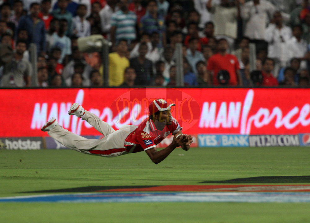 Kings XI Punjab player Sandeep Sharma dives to take a catch of Delhi Daredevils player Mayank Agarwal during match 10 of the Pepsi IPL 2015 (Indian Premier League) between The Kings XI Punjab and The Delhi Daredevils held at the MCA International Stadium in Pune, India on the 15th April 2015.<br /> <br /> Photo by:  Vipin Pawar / SPORTZPICS / IPL