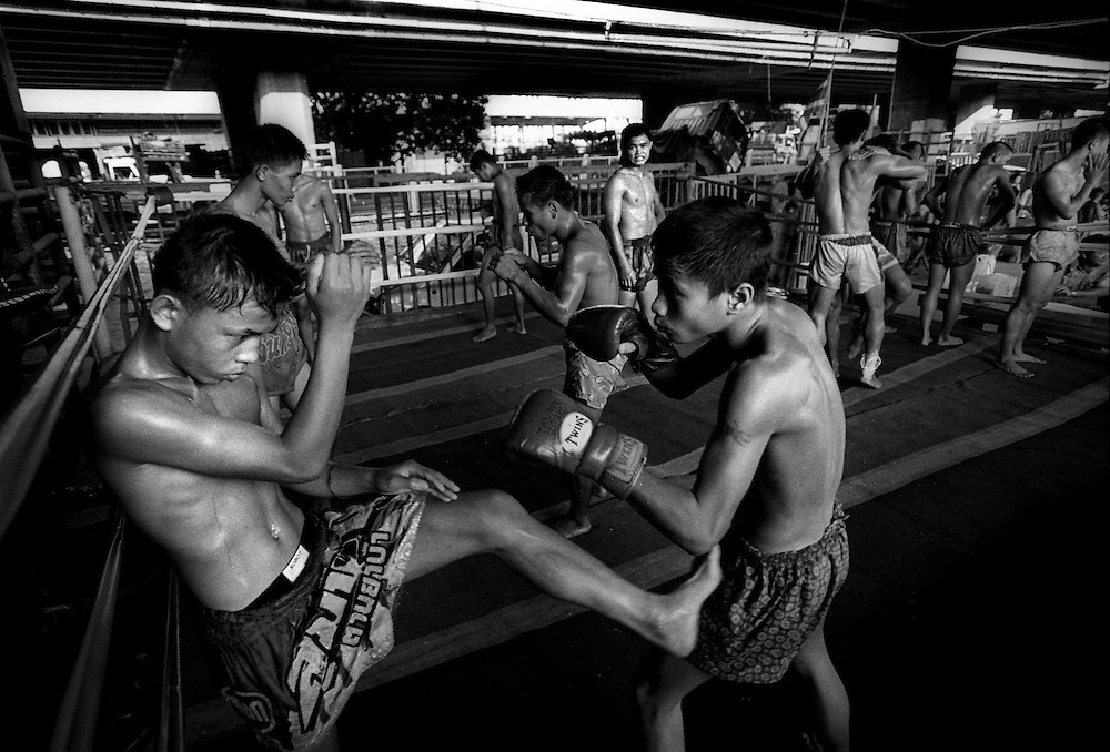 Fighters train at the Muay Thai Boxing Club under the freeway at Khlong Toei, Bangkok Thailand March 2003.©David Dare Parker/AsiaWorks Photography