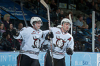 KELOWNA, CANADA - NOVEMBER 6:  Brooks Maxwell #19 and Lukas Sutter #23 of the Red Deer Rebels celebrate a goal against the Kelowna Rockets on NOVEMBER 6, 2013 at Prospera Place in Kelowna, British Columbia, Canada.   (Photo by Marissa Baecker/Shoot the Breeze)  ***  Local Caption  ***
