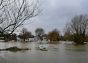 © Licensed to London News Pictures. 29/12/2012. Shepperton, UK Flooded parkland at Shepperton Lock. Flooding along the River Thames today 29th December 2012.Forecasters say the UK can expect heavy rain and winds the coming days. Photo credit : Stephen Simpson/LNP