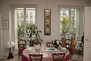 "March 11, 2015, Paris, France.  The Paris' apartment where Georges Wolinski (1934 –2015) and  Maryse Wolinski (1943, Algiers) used to live. Two month after the death of Georges Wolinski, the apartment is full of souvenirs and notes, attesting a half-century-long love relation. In 2016 Maryse Wolinski published the book ""Chérie, je vais à Charlie"" about her husband and the attack on Charlie Hebdo. The cartoonist Georges Wolinski was 80 years old when he was murdered by the French jihadists Chérif en Saïd Kouachi, he was one of the 12 victims of the massacre in the Charlie Hebdo offices on January 7, 2015 in Paris. Charlie Hebdo published caricatures of Mohammed, considered blasphemous by some Muslims. During his life, Georges Wolinski defended freedom, secularism and humour and was one of the major political cartoonists in France. The couple was married and had lived for 47 years together. Photo: Steven Wassenaar."