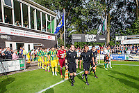 DEN HAAG - SVV Scheveningen - ADO Den Haag , Voetbal , Voorbereiding Seizoen 2015/2016 , Oefenwedstrijd , Sportpark Houtrust , 08-07-2015 , Spelers van ADO Den Haag en SVV Scheveningen komen het veld op