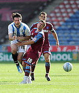 Picture by Graham Crowther/Focus Images Ltd. 07763140036.10/9/11 .Alan Lee of Huddersfield collides with Dave Buchanan of Tranmere during the Npower League 1 game at the Galpharm Stadium, Huddersfield.