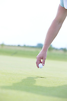 Cropped image of hand holding golf ball