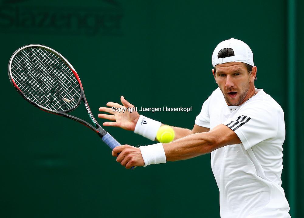 Wimbledon Championships 2013, AELTC,London,<br /> ITF Grand Slam Tennis Tournament, Juergen Melzer (AUT),Aktion,Einzelbild,<br /> Halbkoerper,Querformat,