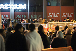 © Licensed to London News Pictures . 26/12/2014 .  Manchester , UK . Crowds of bargain hunters queue outside Next in Manchester's Arndale Centre for a 6AM opening for the Boxing Day Sale . Photo credit : Joel Goodman/LNP