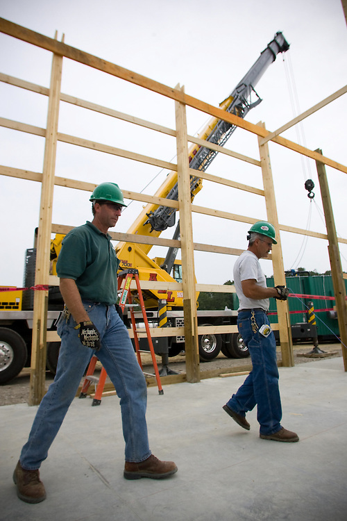 Bill Lawless coordinates fellow workers before a crane lowers the Wright Environmental in-vessel composting unit that is being installed at the Ohio University compost site on Dairy Lane. Photo By: Josh Armstrong