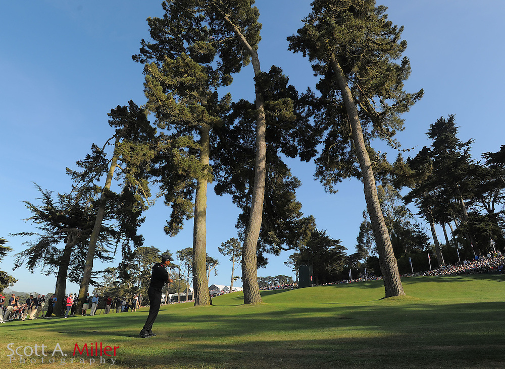 Tiger Woods hits from behind trees along the 17th green during the second round of the 112th U.S. Open at The Olympic Club on June 15, 2012 in San Fransisco. ..©2012 Scott A. Miller