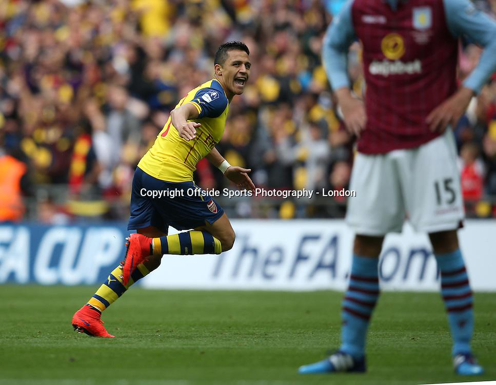 30 May 2015 FA Cup Final - Arsenal v Aston Villa ; Alexis Sanchez celebrates after scoring the second goal for Arsenal.<br />  Photo: Mark Leech.