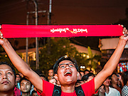 08 NOVEMBER 2015 - YANGON, MYANMAR: A National League for Democracy supporter with a NLD headband cheers as another vote for the NLD was announced during the vote count Sunday. The vote count was shown live on television. The citizens of Myanmar went to the polls Sunday to vote in the most democratic elections since 1990. The National League for Democracy, (NLD) the party of Aung San Suu Kyi is widely expected to get the most votes in the election, but it is not certain if they will get enough votes to secure an outright victory. The polls opened at 6AM. In Yangon, some voters started lining up at 4AM and lines were reported to long in many polling stations in Myanmar's largest city.    PHOTO BY JACK KURTZ