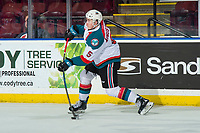 KELOWNA, CANADA - MARCH 13:  Cayde Augustine #5 of the Kelowna Rockets takes a shot from the point against the Spokane Chiefs on March 13, 2019 at Prospera Place in Kelowna, British Columbia, Canada.  (Photo by Marissa Baecker/Shoot the Breeze)