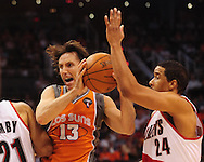 Mar. 21 2010; Phoenix, AZ, USA; Phoenix Suns guard Steve Nash (13) makes a pass against Portland Trailblazers guard Andre Miller (24) in the second half at the US Airways Center. The Suns defeated the Trail Blazers 93 to 87. Mandatory Credit: Jennifer Stewart-US PRESSWIRE.