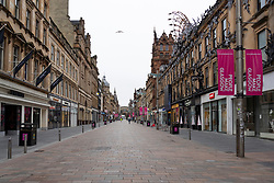 Glasgow, Scotland, UK. 26 March, 2020. Views from city centre in Glasgow on Thursday during the third day of the Government sanctioned Covid-19 lockdown. The city is largely deserted. Only food and convenience stores open. Pictured; Empty Buchanan Street, the city's foremost shopping street. Iain Masterton/Alamy Live News
