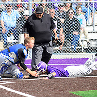 Bloomfield catcher Luke Deifenbaugh(4) tags Miyamura baserunner Marc Rios (5) at home plate Friday. The Miyamura Patriots defeated the Bloomfield Bobcats 6-1 during their first game on their new baseball field located at the Miyamura High School campus in Gallup.