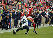 Nov 26, 2017; Santa Clara, CA, USA; San Francisco 49ers cornerback Ahkello Witherspoon (23) breaks up a pass intended for wide receiver Paul Richardson (10) against the Seattle Seahawks at Levi's Stadium. Seattle beat San Francisco 24-13.