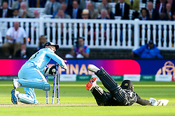 Jos Buttler of England runs out Martin Guptill of New Zealand in the Super Over to win the game and win the  2019 Cricket World Cup - Mandatory by-line: Robbie Stephenson/JMP - 14/07/2019 - CRICKET - Lords - London, England - England v New Zealand - ICC Cricket World Cup 2019 - Final