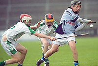 Jack Lawlor and Cian Loy O'loughlin Gaels tackle Peter Casey Na Piarsaigh in the Division 1 Final at Pearse Stadium in the Féile na nGael 2011. Photo:Andrew Downes.