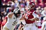 FAYETTEVILLE, AR - OCTOBER 27:  Ty Storey #4 of the Arkansas Razorbacks is hit from behind and fumbles the ball by Frank Coppet #2 and is then hit by Drew Birchmeier #91 of the Vanderbilt Commodores at Razorback Stadium on October 27, 2018 in Fayetteville, Arkansas.  The Commodores defeated the Razorbacks 45-31.  (Photo by Wesley Hitt/Getty Images) *** Local Caption *** Ty Storey; Frank Coppet; Drew Birchmeier