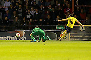 Oxford United forward Danny Hylton  puts the ball past York City goalkeeper Scott Flinders during the Sky Bet League 2 match between York City and Oxford United at Bootham Crescent, York, England on 29 September 2015. Photo by Simon Davies.