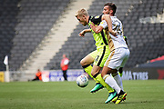 MKDons defender Baily Cargill (26) and Exeter City forward Jayden Stockley (11) during the EFL Sky Bet League 2 match between Milton Keynes Dons and Exeter City at stadium:mk, Milton Keynes, England on 25 August 2018.