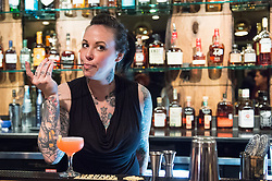 Leslie Ross checks a cocktail behind the bar at Johnny's Gold Brick. (Editorial)