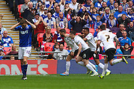 Josh McQuoid of Peterborough United (2nd left) celebrates scoring the opening goal during the Johnstone's Paint Trophy Final match at Wembley Stadium, London<br /> Picture by David Horn/Focus Images Ltd +44 7545 970036<br /> 30/03/2014