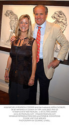 Artist MICHELLE PEARSON COOPER and her husband JUSTIN CADBURY, at an exhibition in London on 10th June 2003.PKG 22