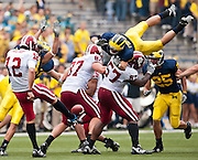 Jon Conover of the University of Michigan attempts to block a punt against Indiana.