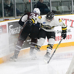 "TRENTON, ON  - MAY 3,  2017: Canadian Junior Hockey League, Central Canadian Jr. ""A"" Championship. The Dudley Hewitt Cup. Game 3 between Powassan Voodoos and the Dryden GM Ice Dogs.  Andy Baker #11 of the Powassan Voodoos makes the hit on  Cody Wardner #20 of the Dryden GM Ice Dogs  during the first period.<br /> (Photo by Tim Bates / OJHL Images)"