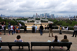 &copy; Licensed to London News Pictures. 30/07/2018<br /> GREENWICH, UK.<br /> View across London Canary Wharf and Queen's House.<br /> A cloudy grey day in London, Greenwich Park, Greenwich.<br /> Photo credit: Grant Falvey/LNP