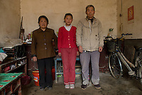 Zhang Ya'nan,12 whose parents work on the coast is an abandoned child or left behind -« liushou ertong » in Chinese - with her grandmother Yu Enlan, 65 and grandfather Zhang Xinzhi,68 in their home in Balizhuang village in Henan near Kaifeng. March 23rd 2008. ©Lionel DERIMAIS/2008