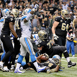 Dec 21, 2015; New Orleans, LA, USA; Detroit Lions middle linebacker Tahir Whitehead (59) celebrates after a stop against New Orleans Saints running back Tim Hightower (34) at the goal line during the second quarter a game at the Mercedes-Benz Superdome. Mandatory Credit: Derick E. Hingle-USA TODAY Sports