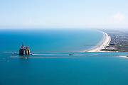 """Offshore Oil platform """"OLYMPUS"""" being towed offshore from Kiewit in Ingleside, Texas by Crowley Maritime Corporation's OCEAN CLASS Tugs. (Aerial Photography by Tim Burdick)"""