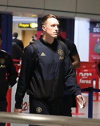 Phil Jones is spotted on his way to catch a flight as the team fly to Turin on Tuesday afternoon to play Juventus in The Champions League on Wednesday night.