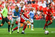 Manchester City midfielder Kevin de Bruyne (17) tussles with Liverpool midfielder Jordan Henderson (14) during the FA Community Shield match between Manchester City and Liverpool at Wembley Stadium, London, England on 4 August 2019.
