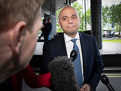 © Licensed to London News Pictures. 15/06/2019. London, UK. Conservative Party leadership candidate, Home Secretary Sajid Javid answers reporters questions as he arrives at a hustings event in central London. The remaining candidates in the leadership race will face a second round of votes in Parliament on Tuesday next week. Photo credit: Peter Macdiarmid/LNP